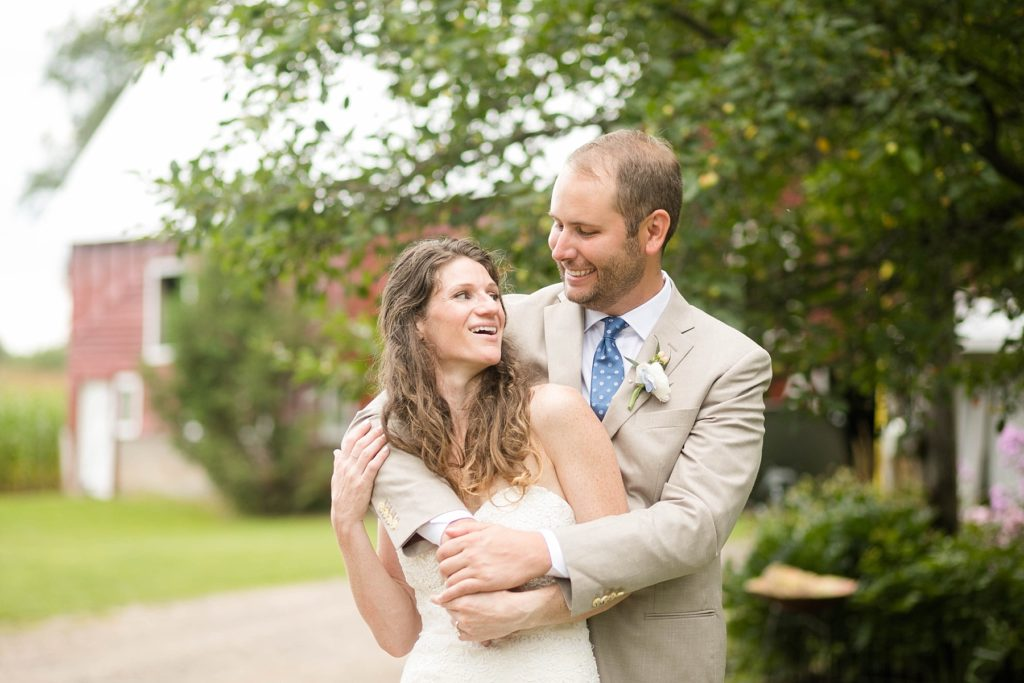 couple smiling at each other at their boho ladysmith wi wedding