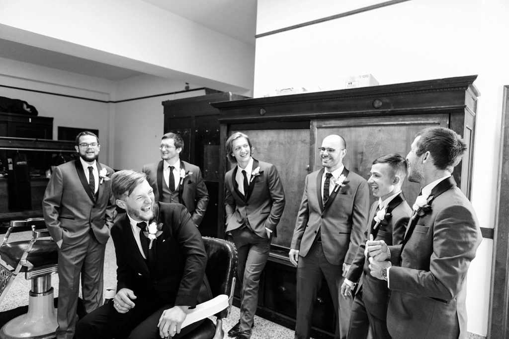 groom and groomsmen getting ready  at Masonic Ballroom in Eau Claire