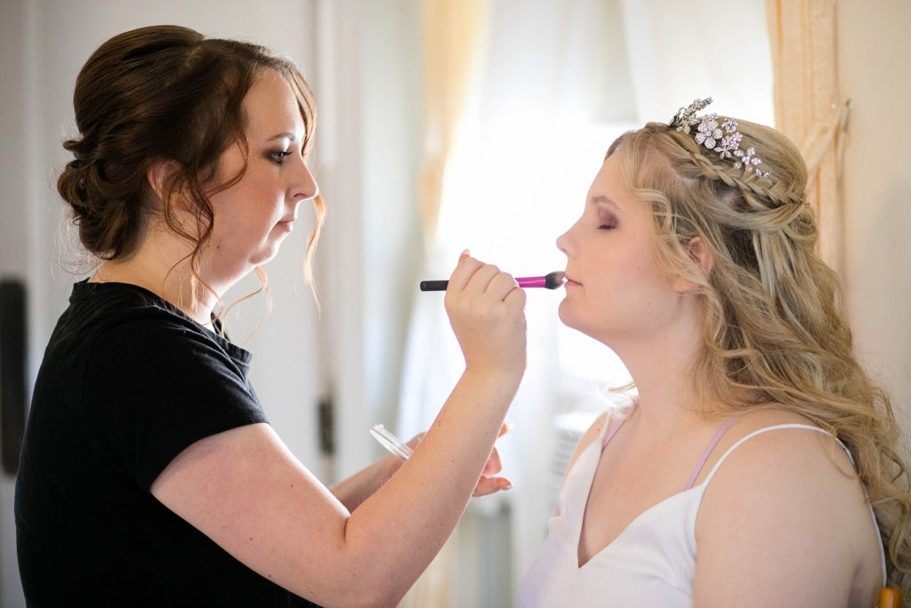 bride getting her makeup done  at Masonic Ballroom in Eau Claire