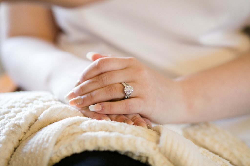 brides hands on her lap  at Masonic Ballroom in Eau Claire