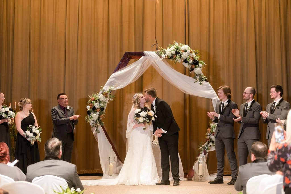 first kiss during the ceremony  at Masonic Ballroom in Eau Claire