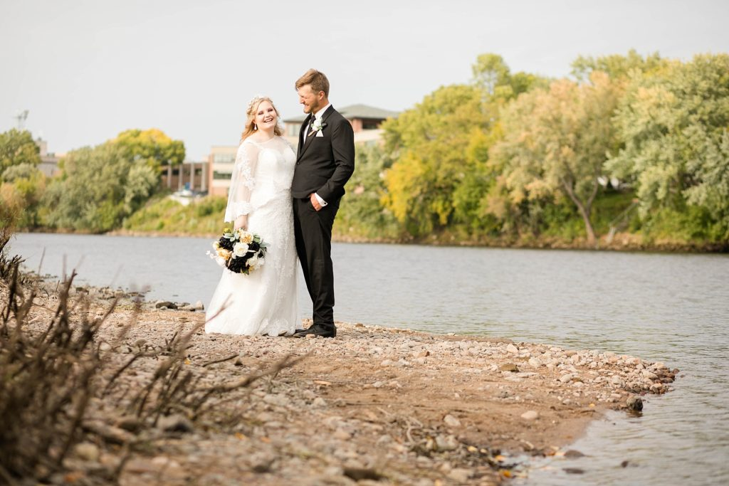 couple on the riverbank at Owen Park in Eau Claire