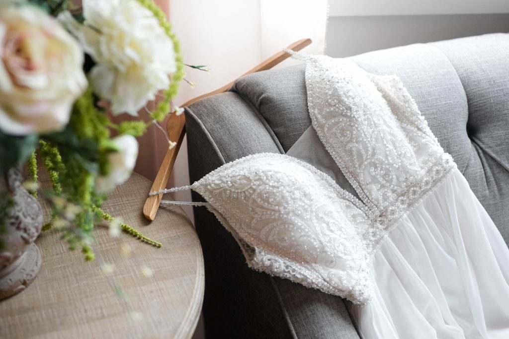 brides dress draped over a couch in the bridal suite at Lilydale in Chippewa Falls, WI