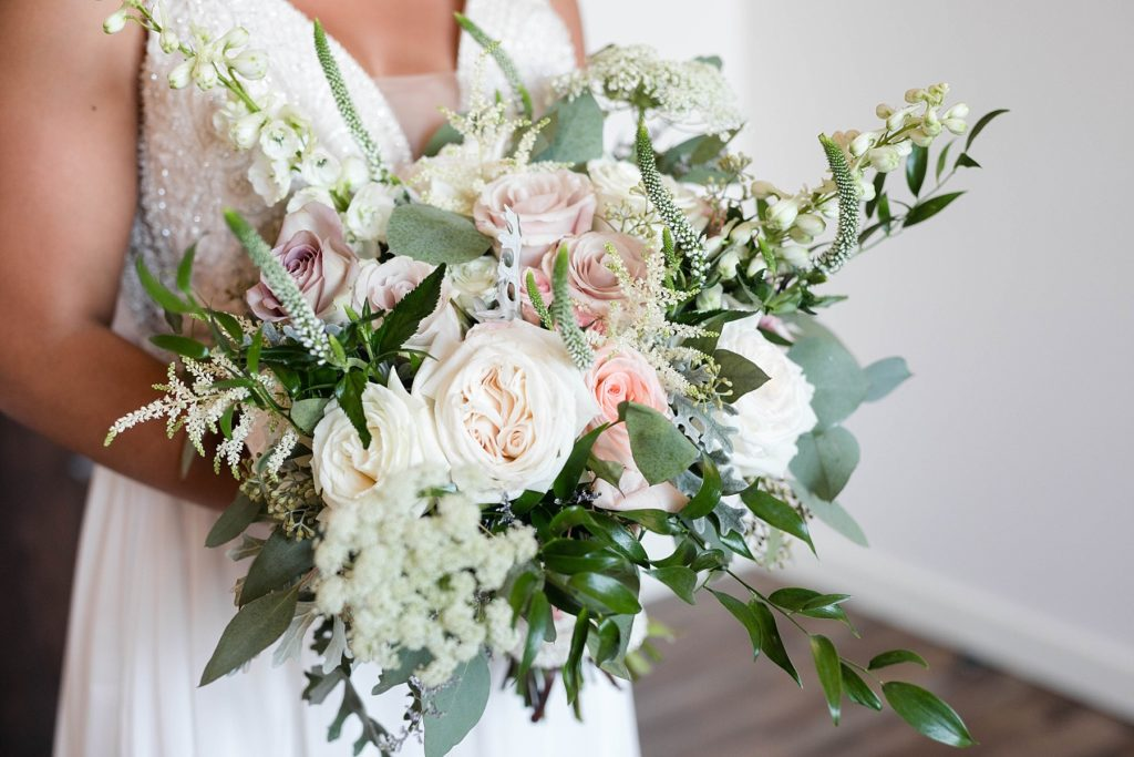 bride holding flowers by Alma Floral at Lilydale in Chippewa Falls, WI