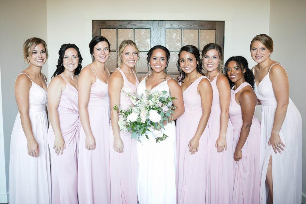 bridesmaids and bride smiling at the camera in the bridal suite at Lilydale in Chippewa Falls, WI