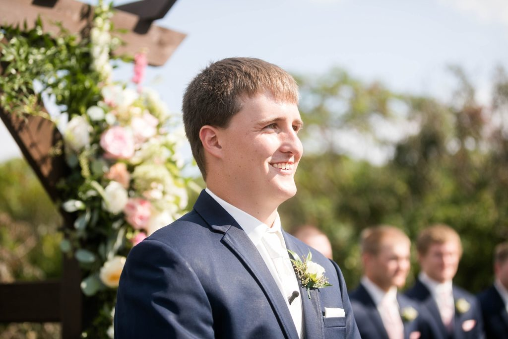 groom watching the bride walk down the aisle outside at Lilydale in Chippewa Falls, WI