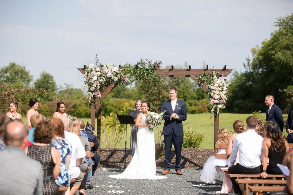 couple looking out at their guests during a wedding ceremony at Lilydale in Chippewa Falls, WI