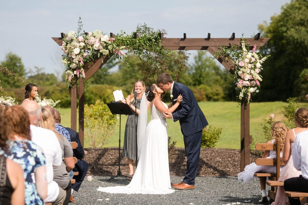 couple kissing outside during ceremony at Lilydale in Chippewa Falls, WI