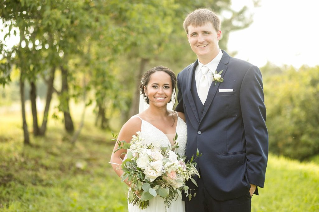 couple smiling at the camera on their wedding day at Lilydale in Chippewa Falls, WI