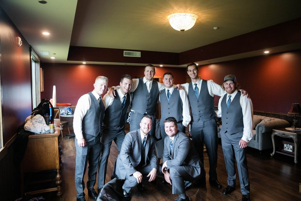 groom and groomsmen in the grooms room at Lilydale in Chippewa Falls during their fall wedding