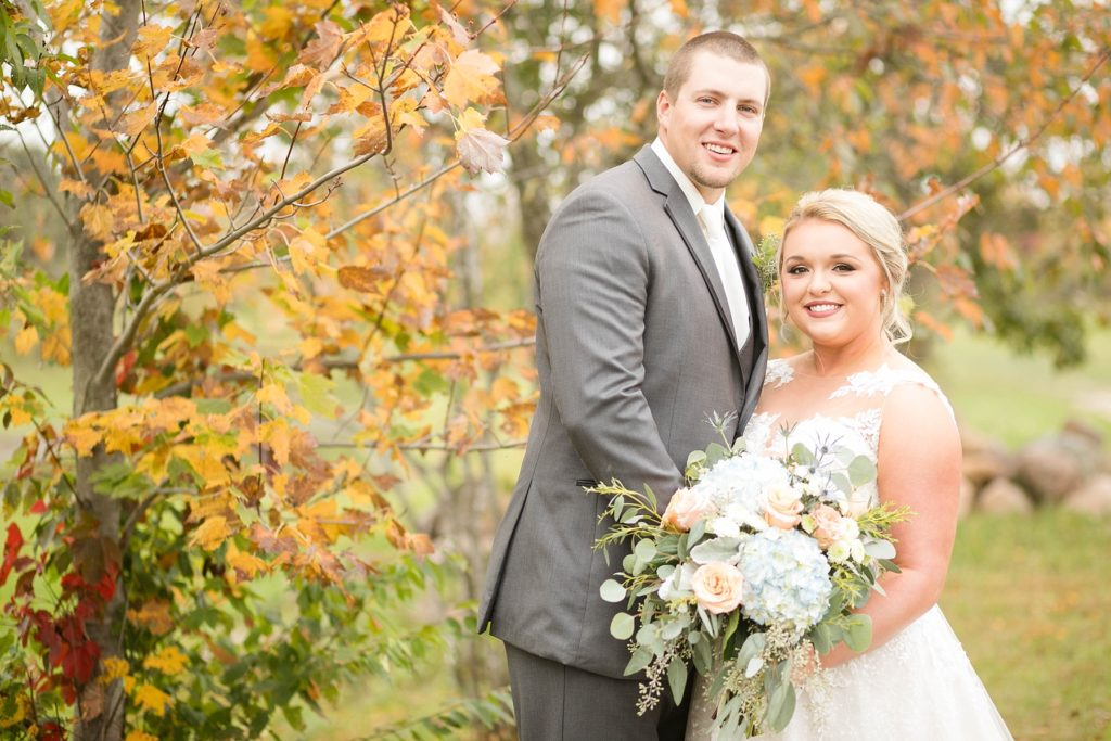 couple smile during their first look outside at Lilydale in Chippewa Falls during their fall wedding