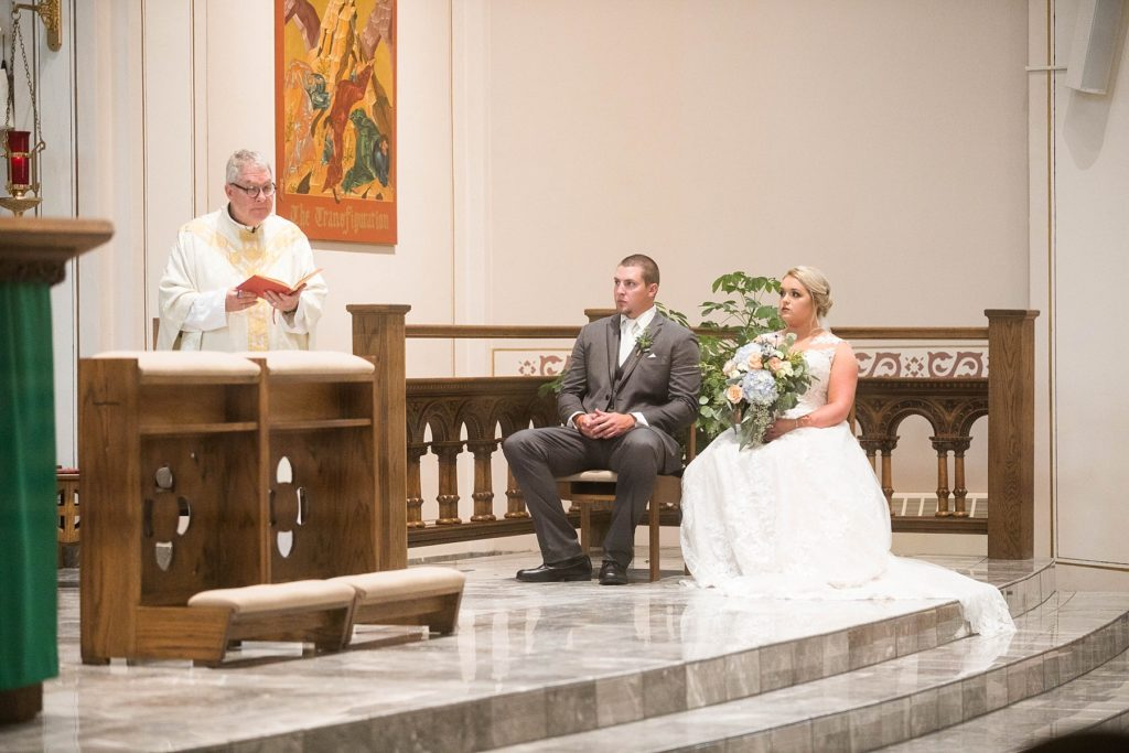 couple sitting at St. Charles of Borromeo in Chippewa Falls for their wedding