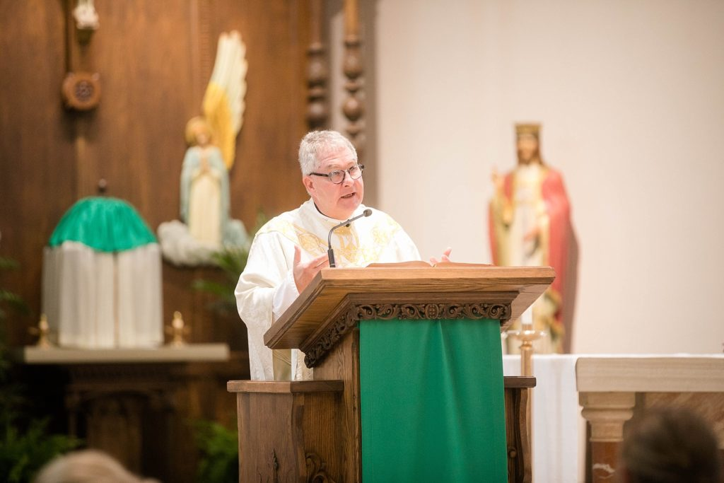 priest at St. Charles of Borromeo in Chippewa Falls for their wedding