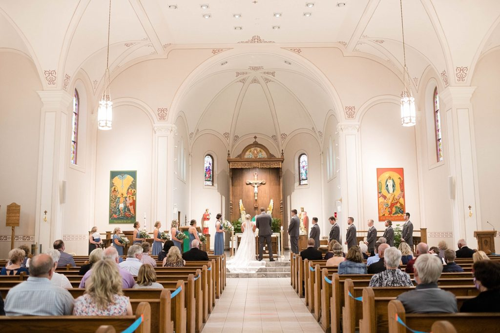 couple during wedding rites at St. Charles of Borromeo in Chippewa Falls for their wedding