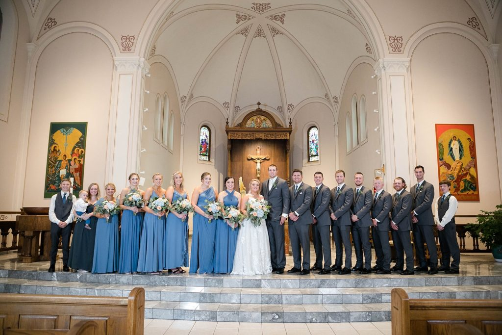 formal bridal party portrait at St. Charles of Borromeo in Chippewa Falls for their wedding