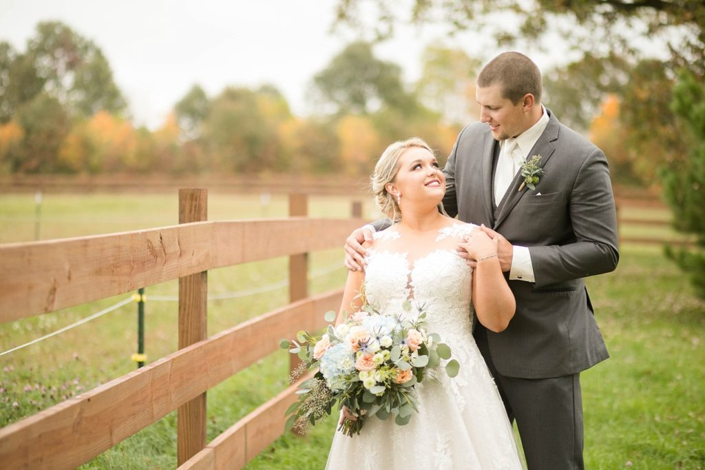 couple smile at each other at their fall wedding at Lilydale in Chippewa Falls