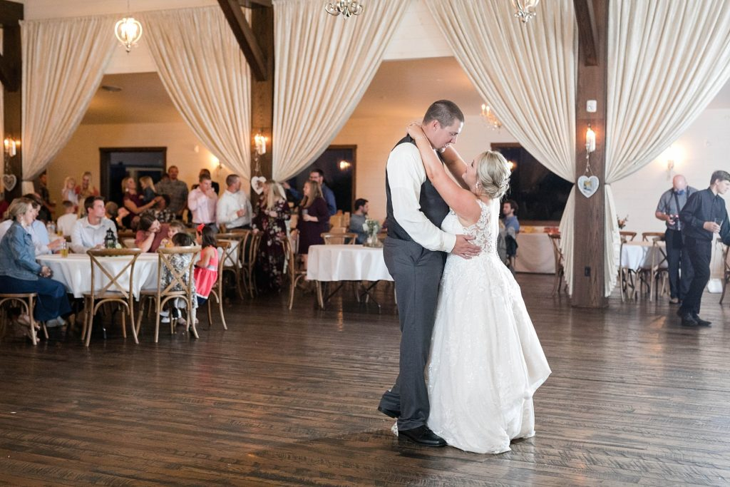 couple shares their first dance at their fall wedding at Lilydale in Chippewa Falls