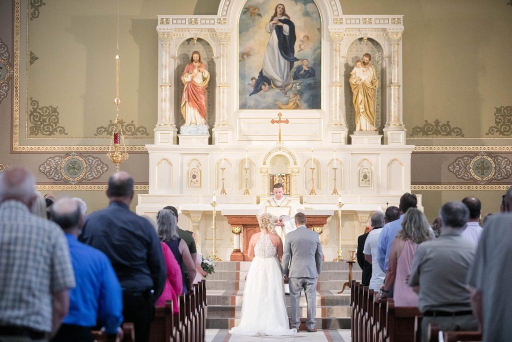 bride and groom at ceremony at Notre Dame Catholic Church in Chippewa Falls
