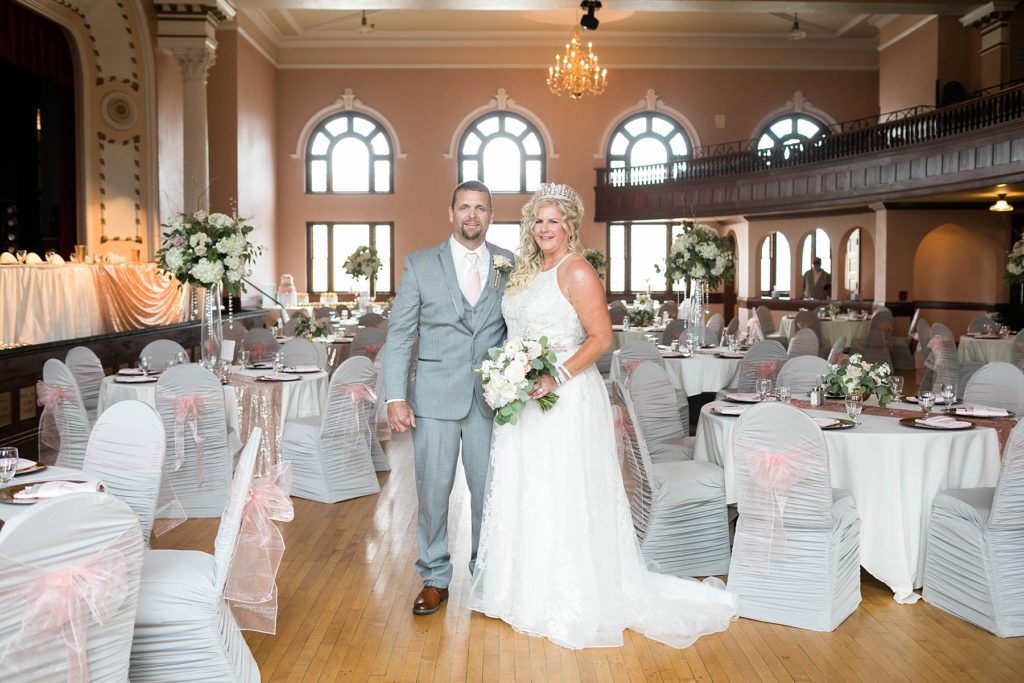 couple at their reception at glam wedding reception at the Heyde Center in Chippewa Falls