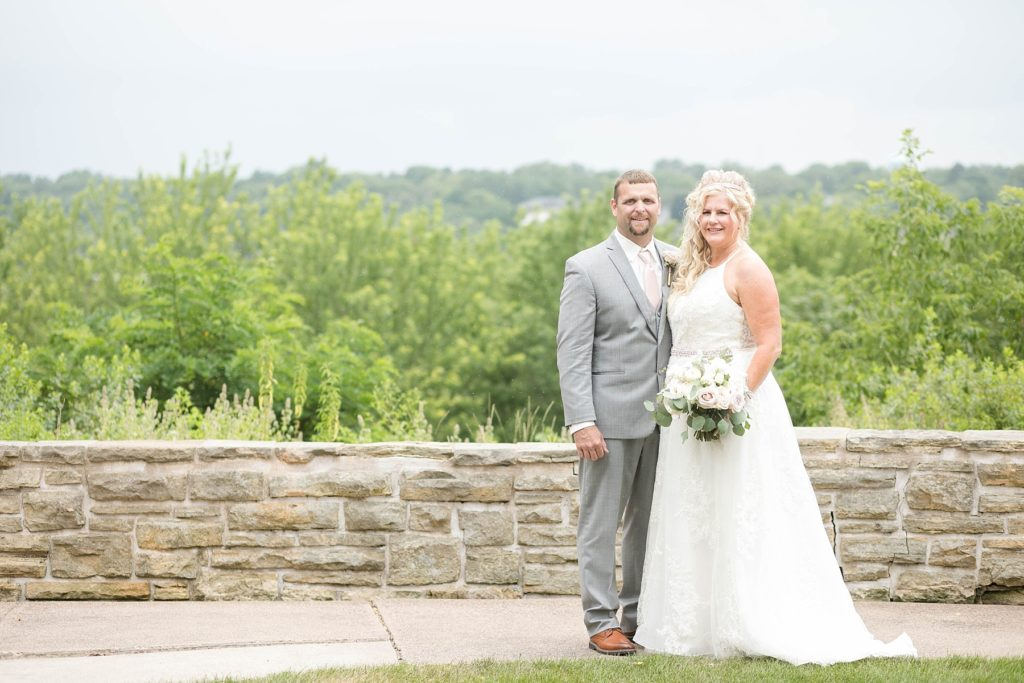 couple outside the Heyde Center overlooking Chippewa Falls on their wedding day