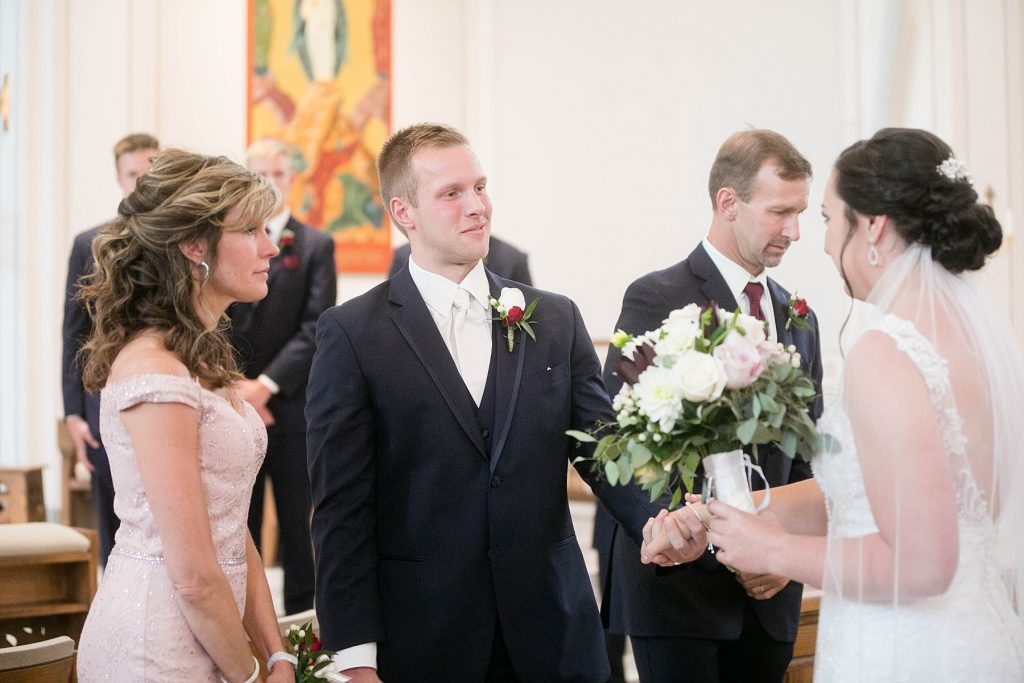 groom and bride together at St. Charles Borromeo Catholic Church in Chippewa Falls
