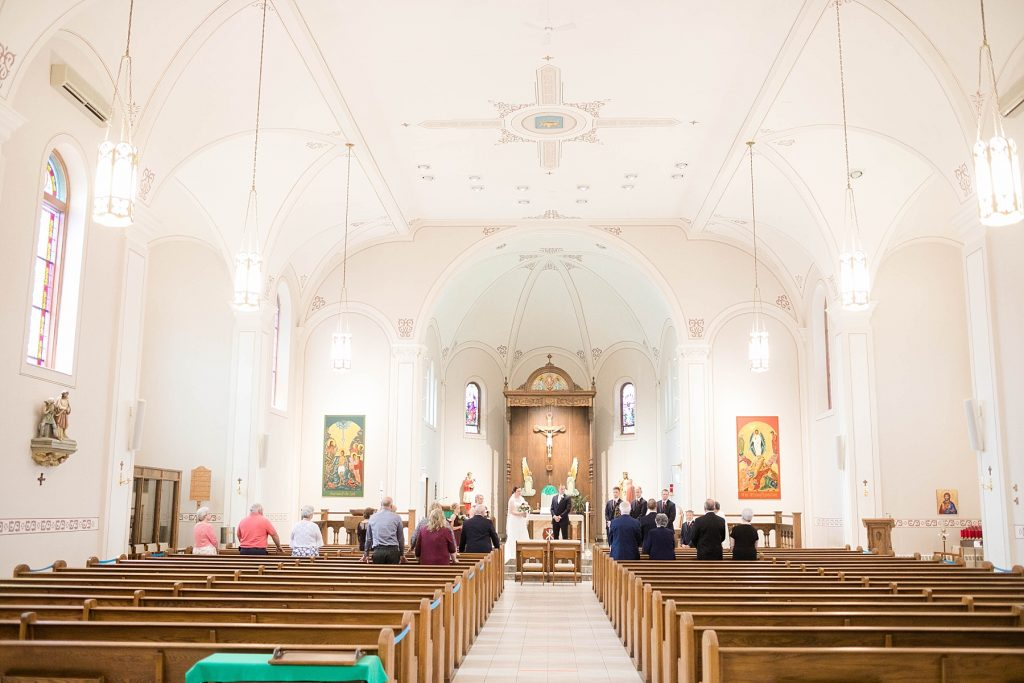 intimate wedding ceremony at St. Charles Borromeo Catholic Church in Chippewa Falls during the pandemic