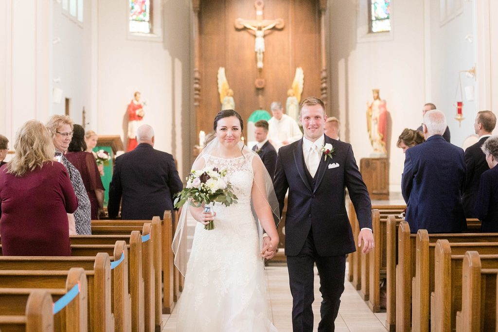 recessional at wedding ceremony at St. Charles Borromeo Catholic Church in Chippewa Falls