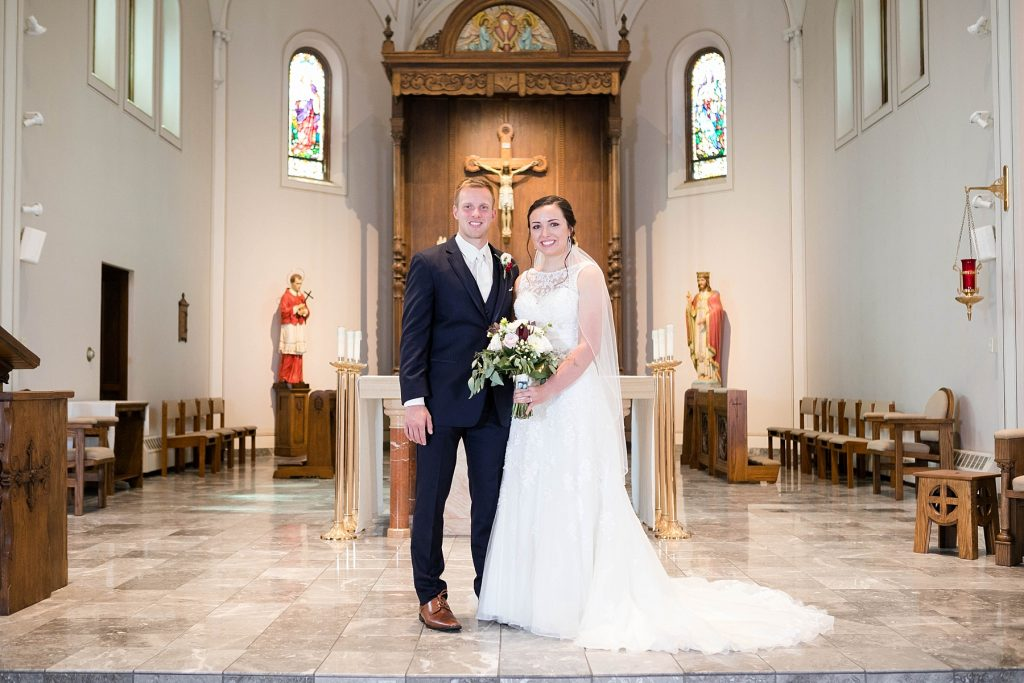 bride and groom formal portrait at St. Charles Borromeo Catholic Church in Chippewa Falls