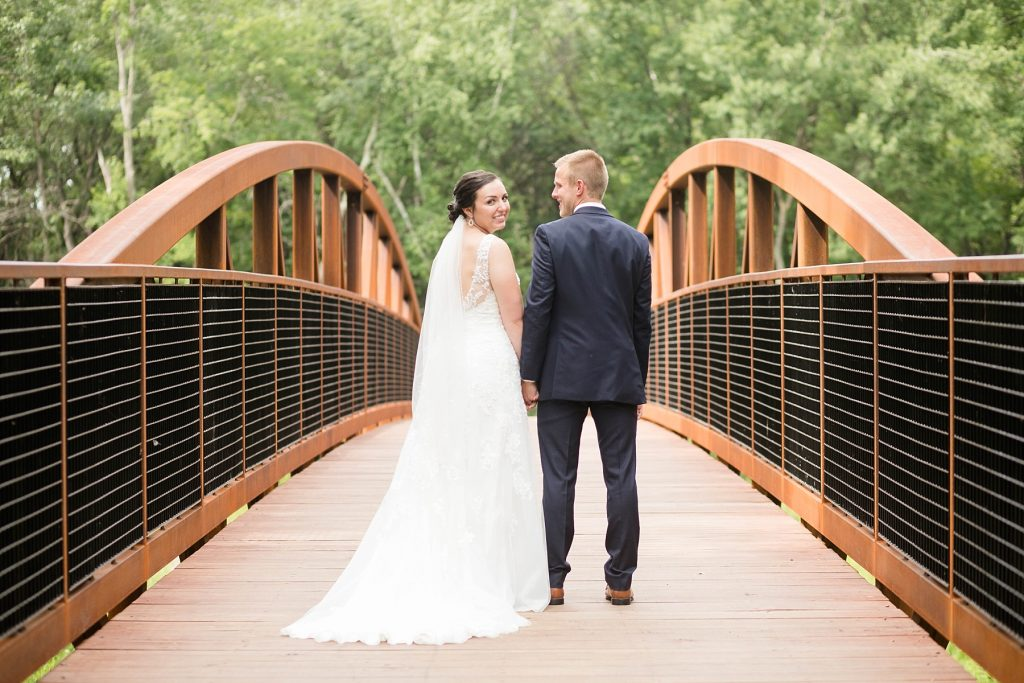 bride and groom on bridge at Erickson Park in Chippewa Falls