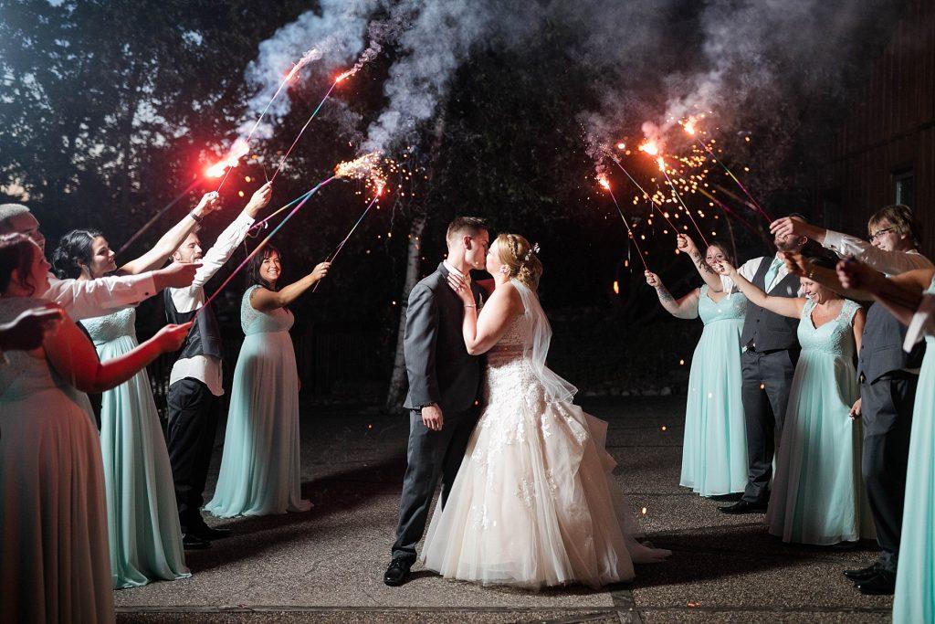 couple kissing under sparklers at Pettibone Resort wedding in La Crosse WI