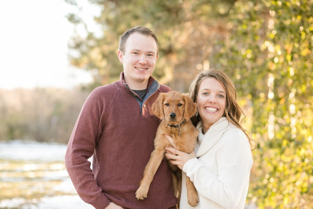 couple pose with golden retriever for their Eau Claire couples session with new puppy