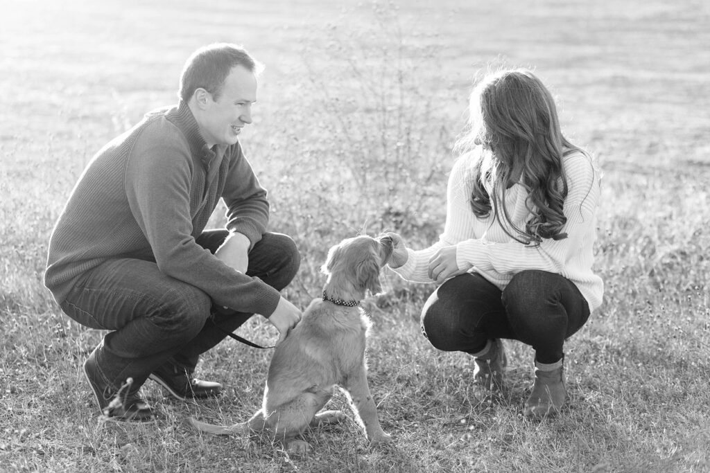 couple feeding puppy treats for their Eau Claire couples session with new puppy