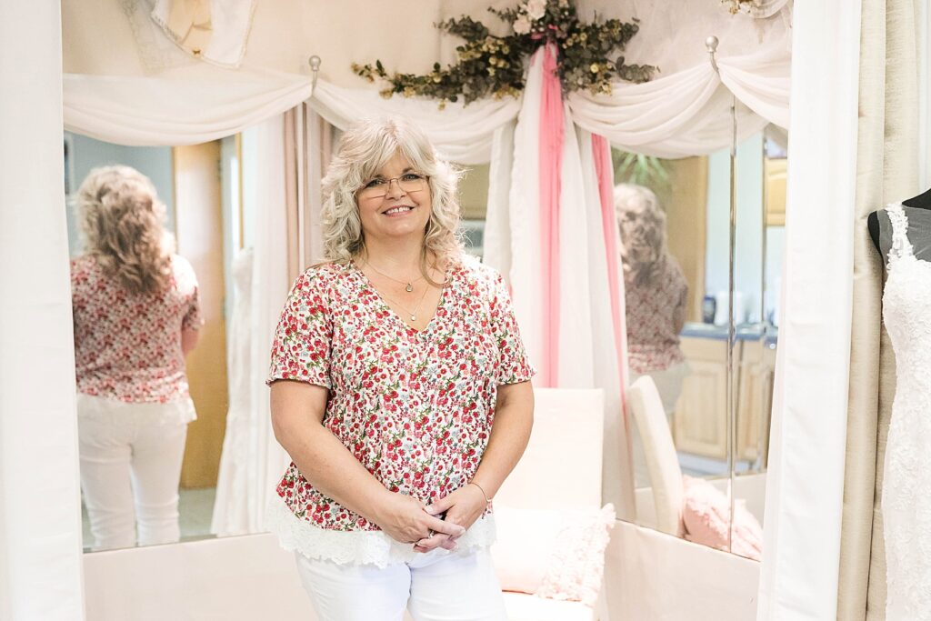 Kelley Jo of The Fitting Room & Co in Wheeler stands in her fitting room where she does custom alterations for bridal attire.
